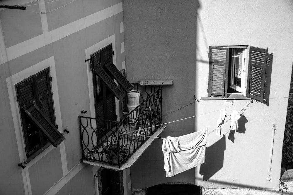 white textile on black metal railings