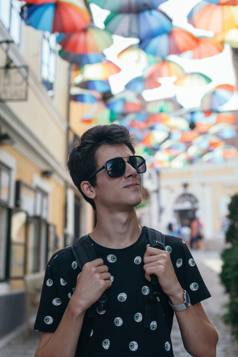 boy in black and white crew neck shirt wearing black sunglasses