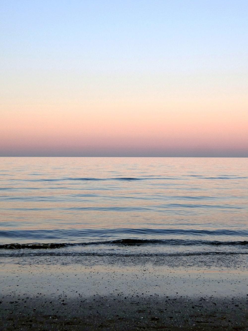 ocean water under blue sky during daytime