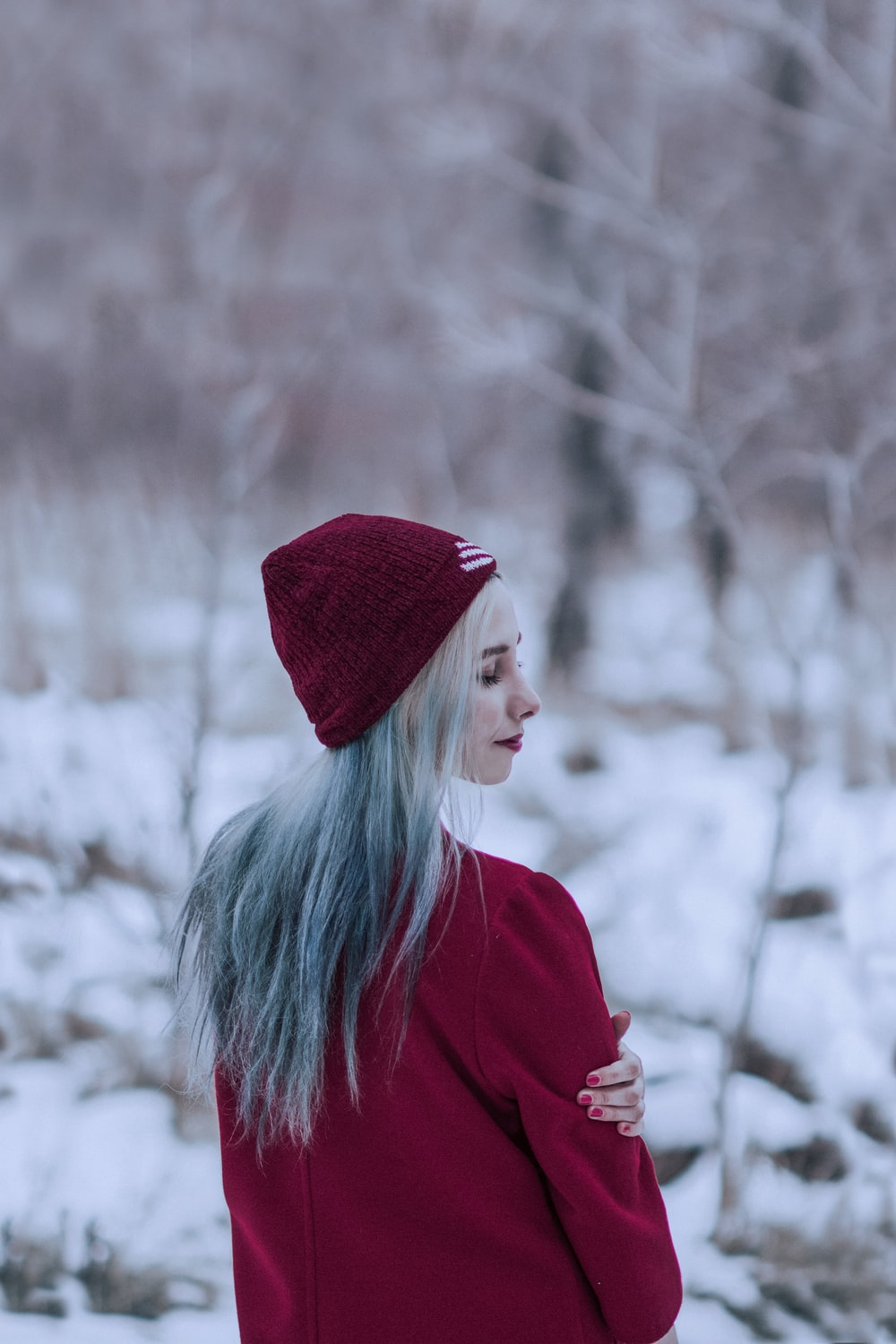 woman in red knit cap and red sweater