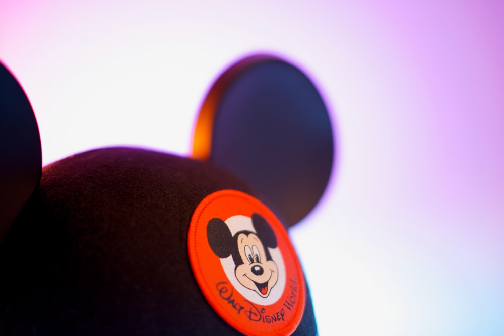 black and orange mickey mouse cap
