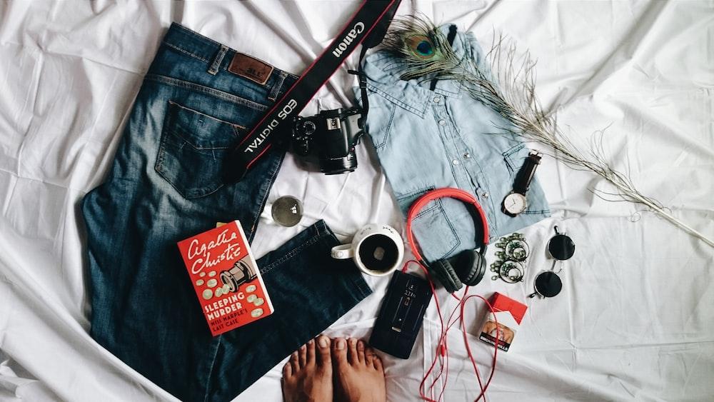 black and silver dslr camera on blue denim jeans