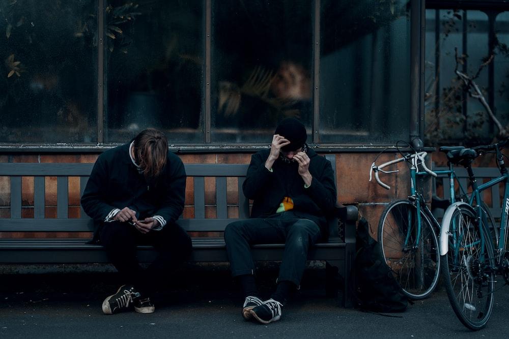 2 women sitting on bench
