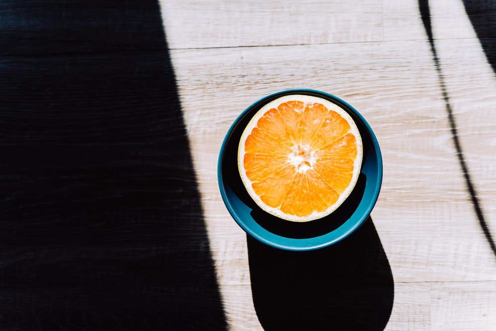 orange and white round container