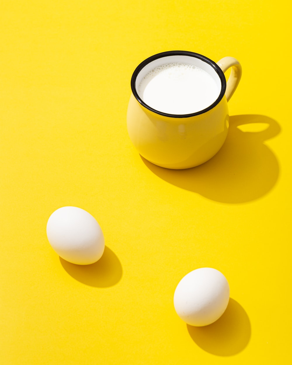 white ceramic mug with white egg