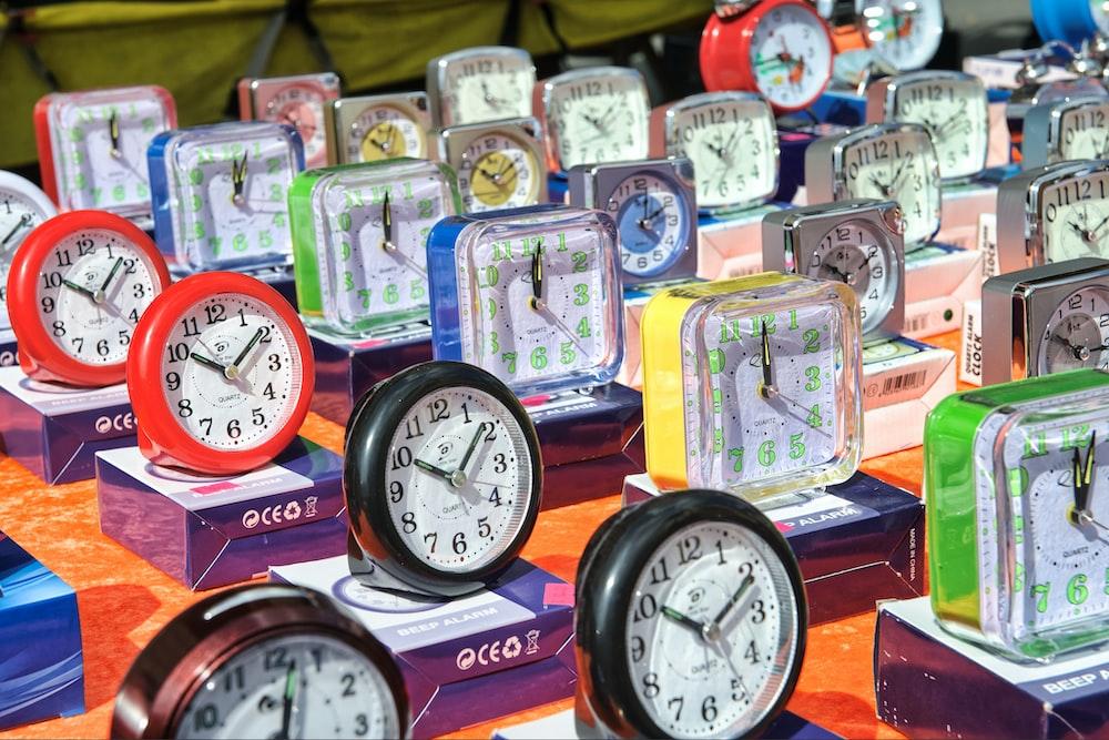 brown and white analog clock at 10 10