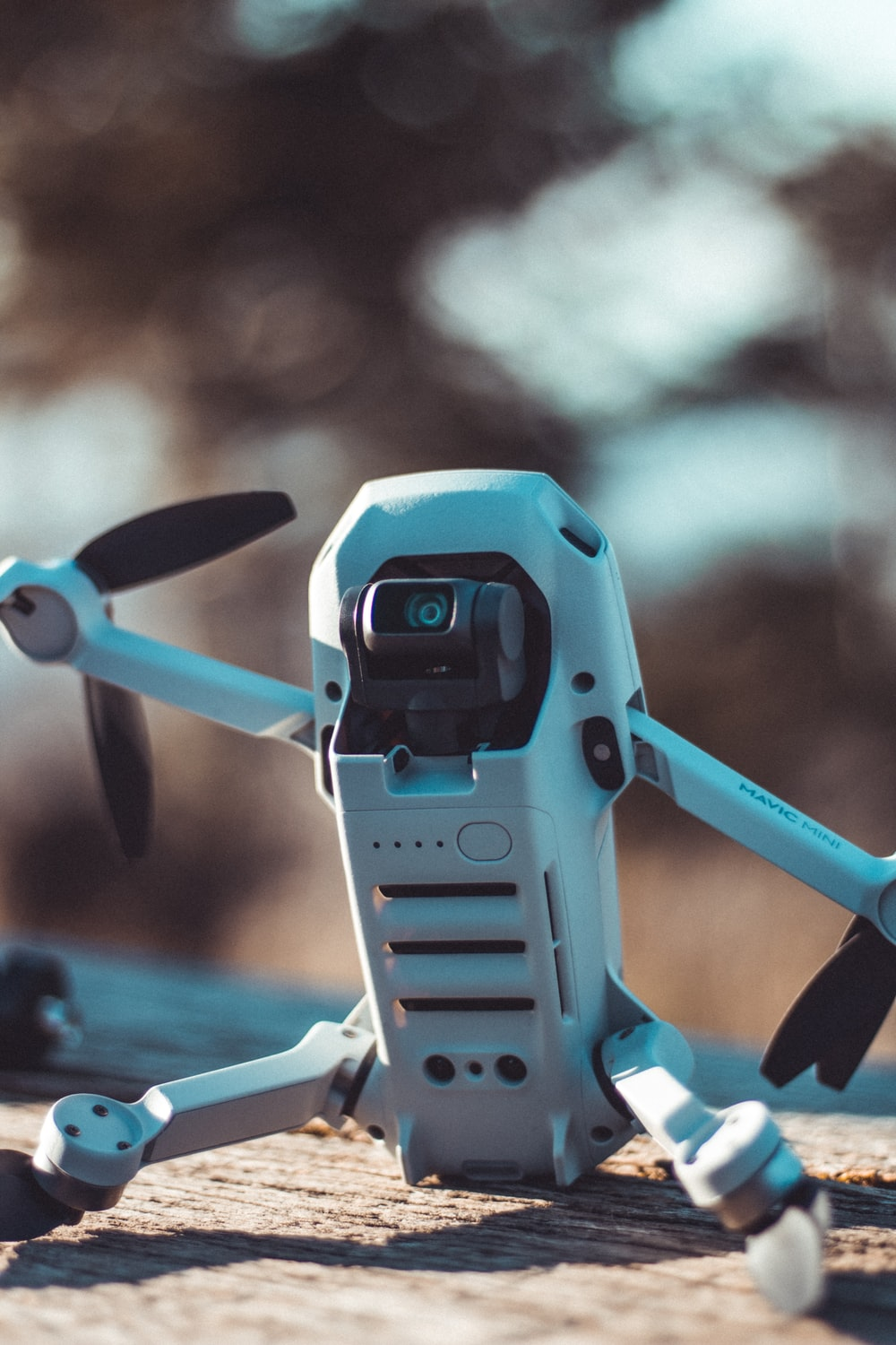 blue and black drone in close up photography