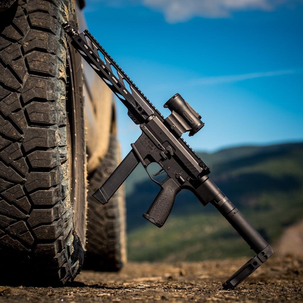 black airsoft rifle on black tire