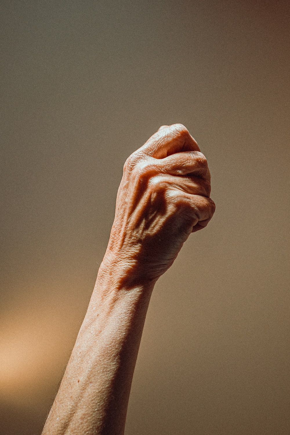 persons left hand on gray surface