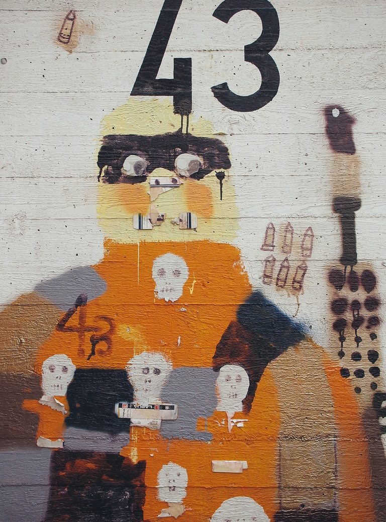 white orange and black wall graffiti