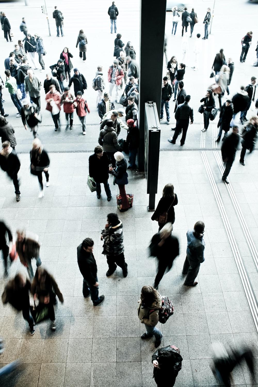people walking on gray concrete floor