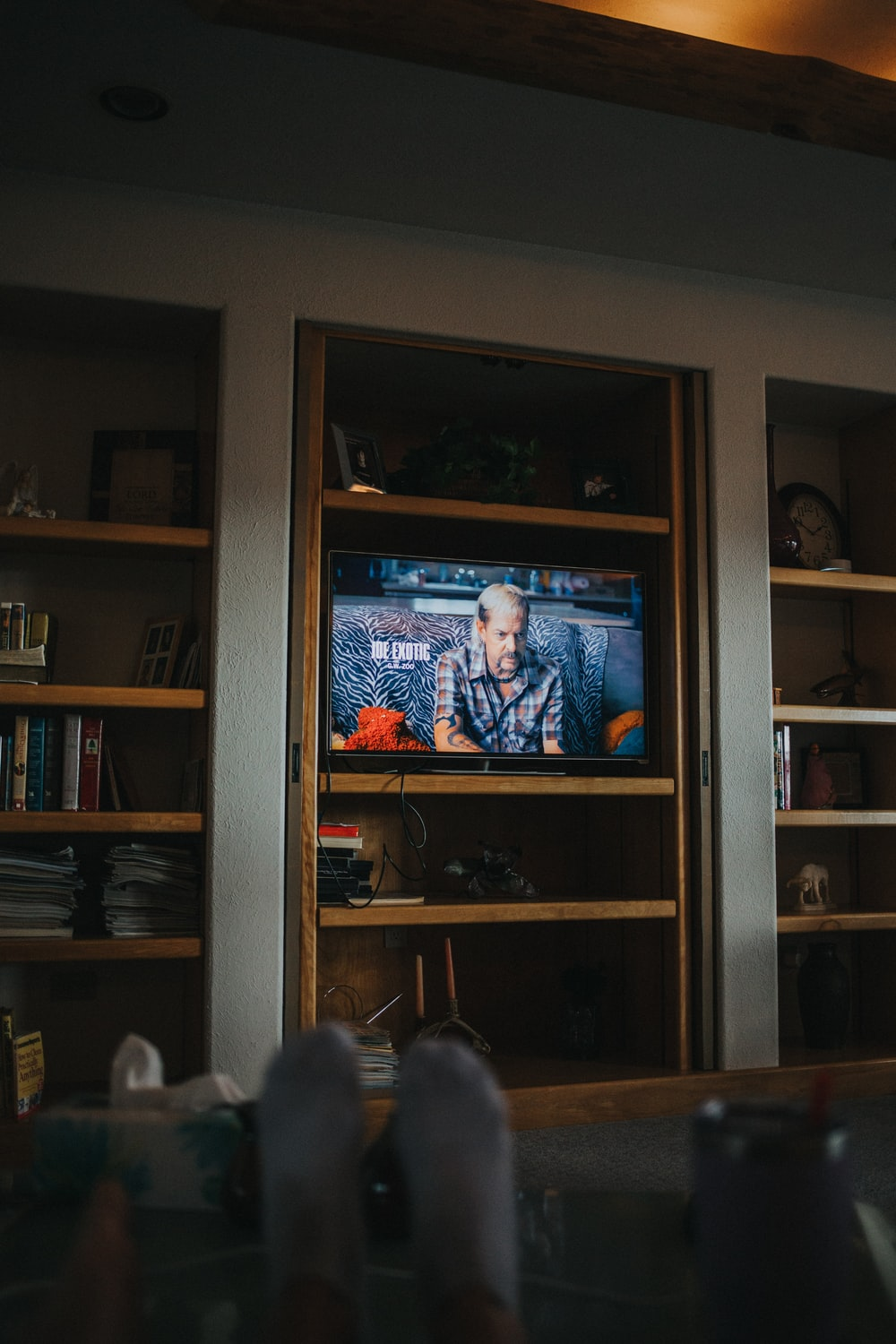 black flat screen tv turned on displaying man in blue suit jacket