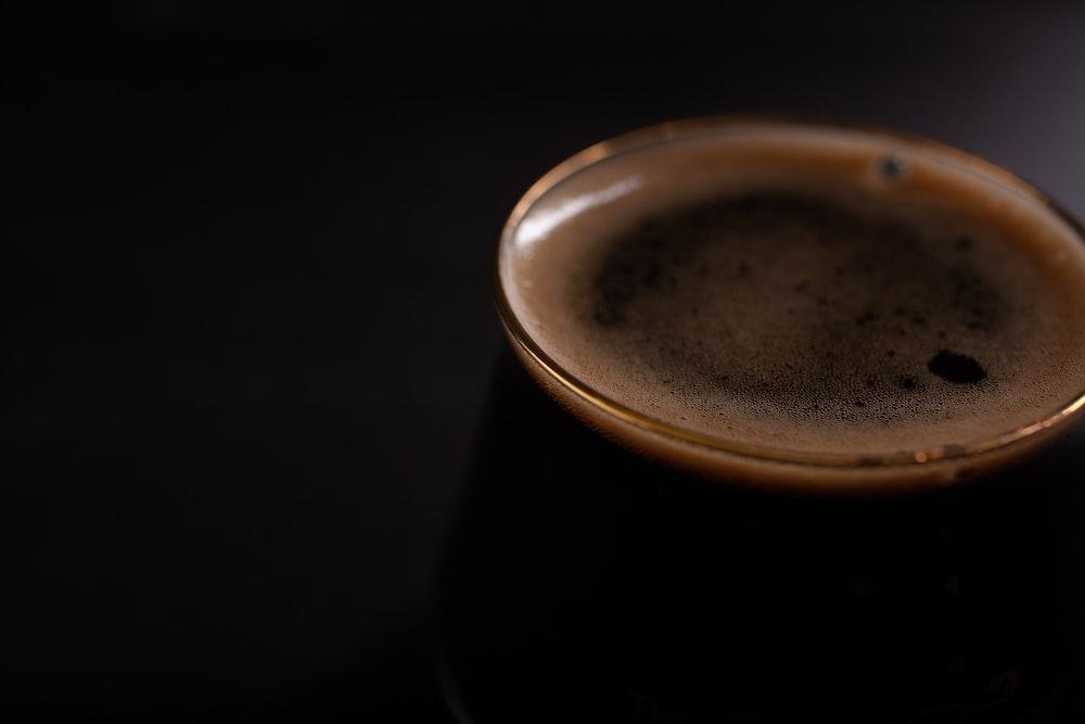 black ceramic mug with brown liquid