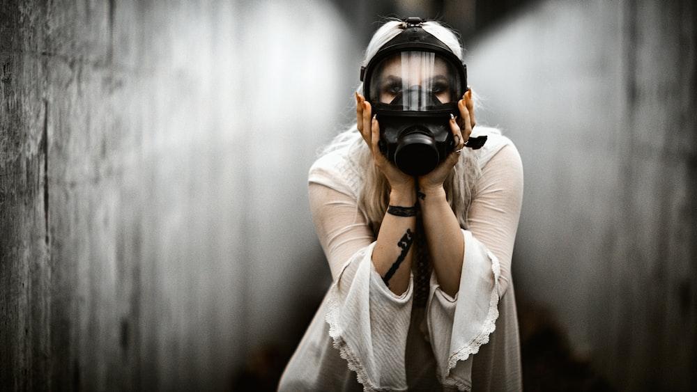 woman in white long sleeve shirt wearing black headphones