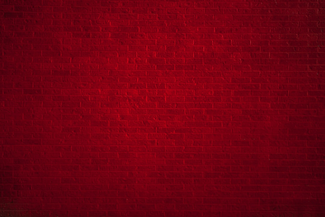 Painted red brick wall texture