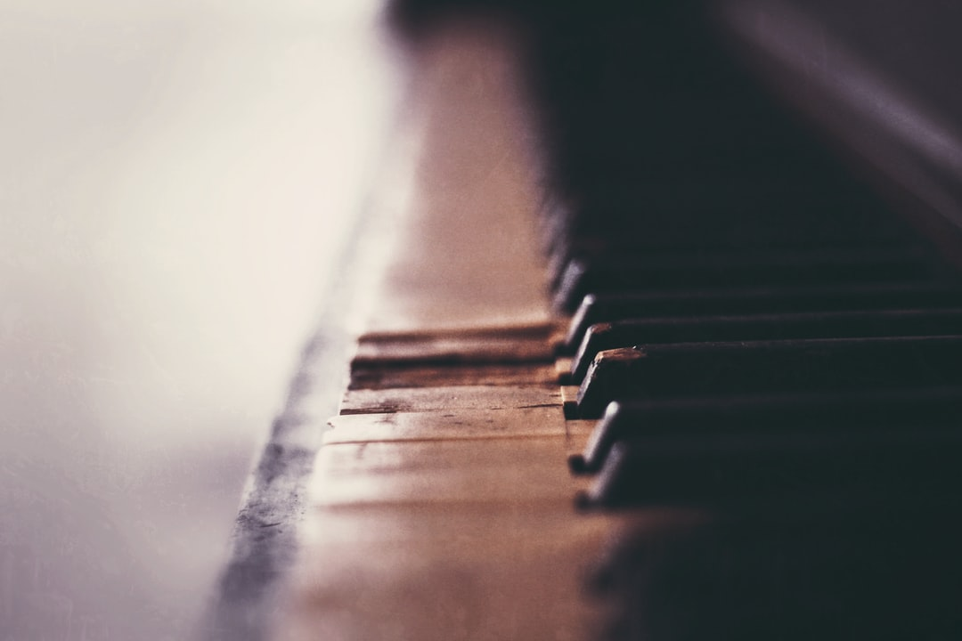 Grayscale Photo of Piano Keys - unsplash