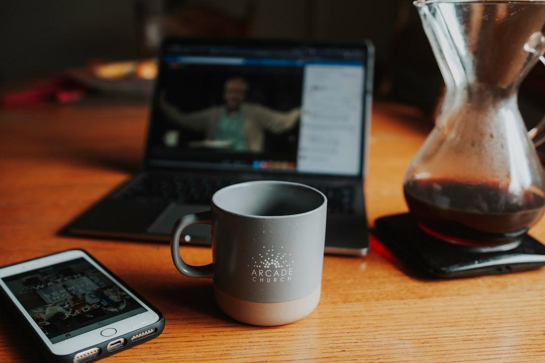 White Ceramic Mug Beside Black Laptop Computer - unsplash
