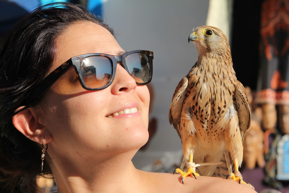 brown eagle on womans face