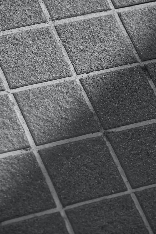 grayscale photo of concrete brick