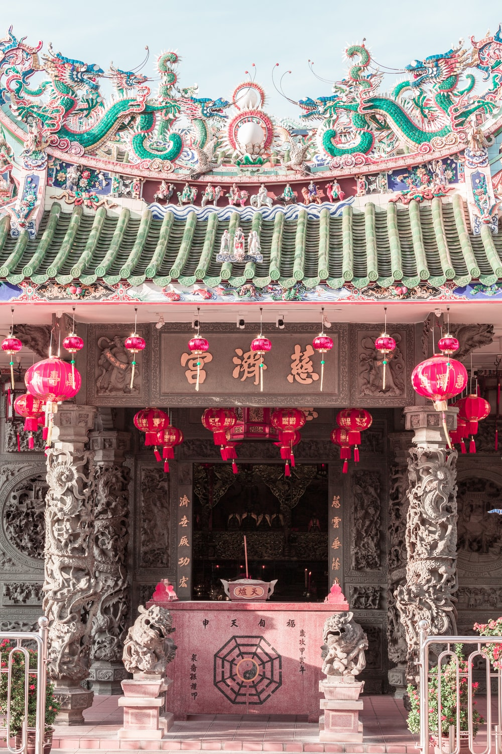 green and pink temple with pink and white wall