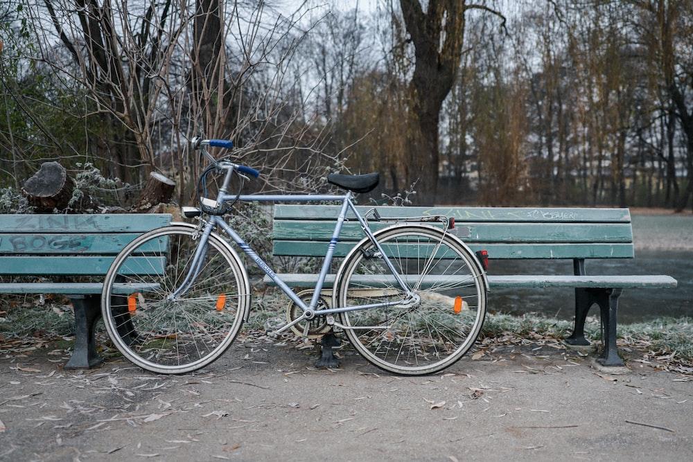 blue city bike on gray wooden bench