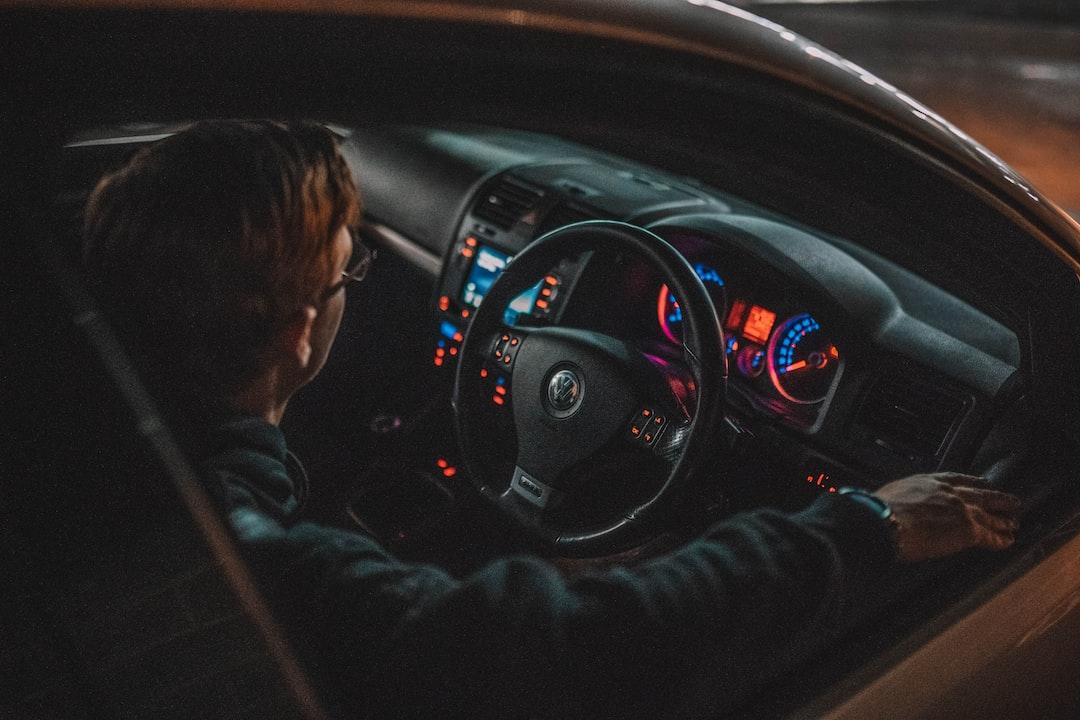 Man In Black Jacket Driving Car - unsplash