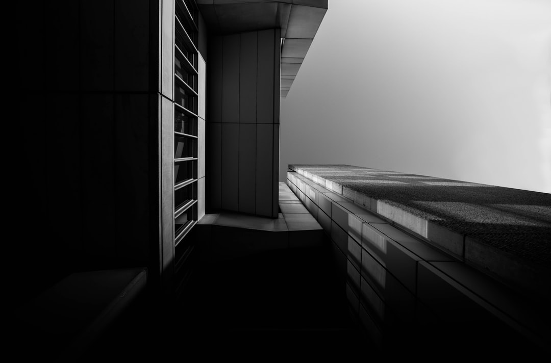 Grayscale Photo of Concrete Building - unsplash