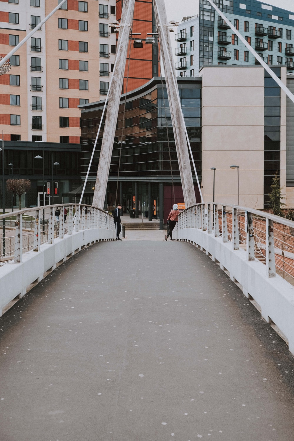 white bridge with people walking on it