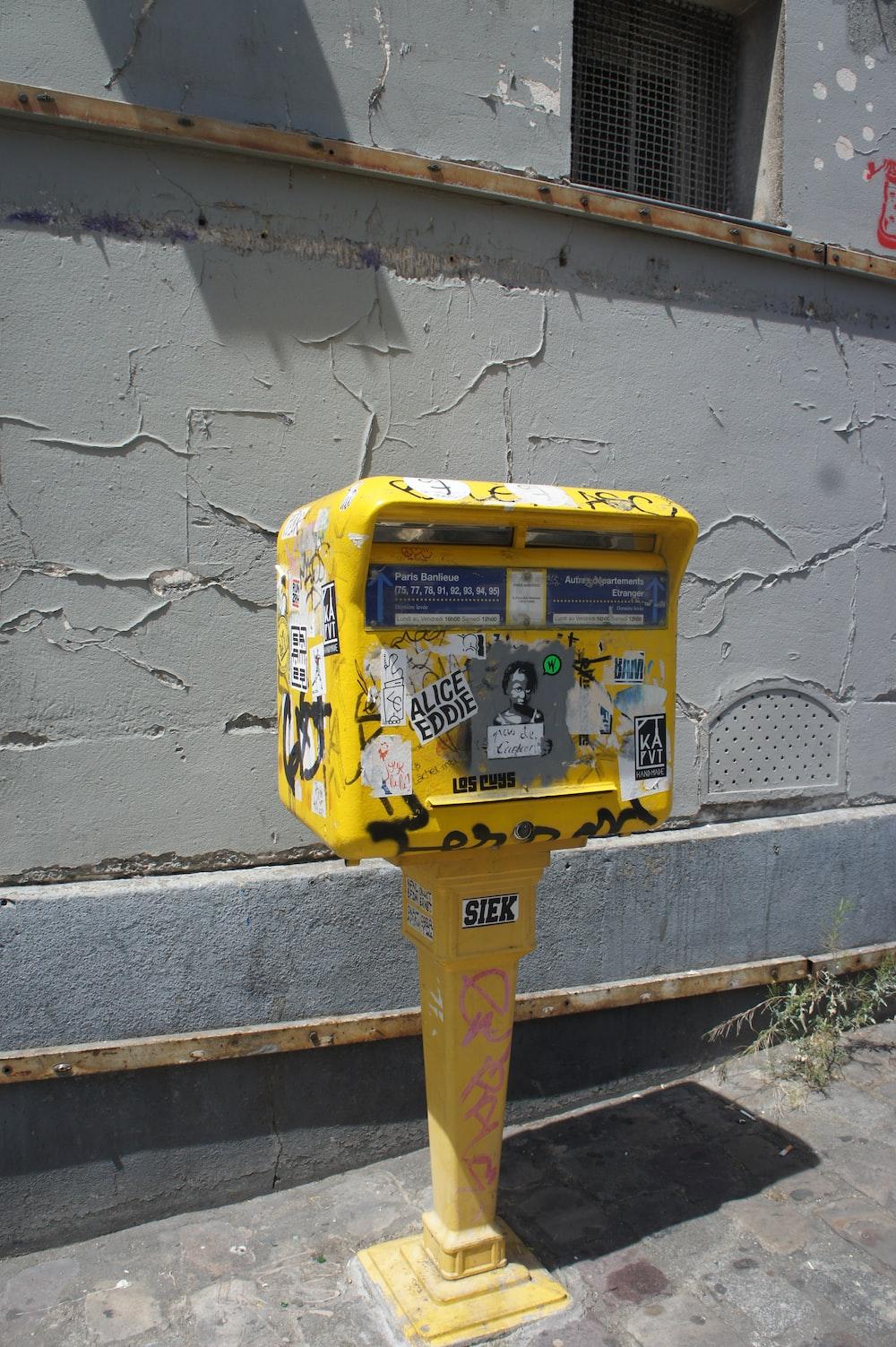 yellow and blue steel trash bin