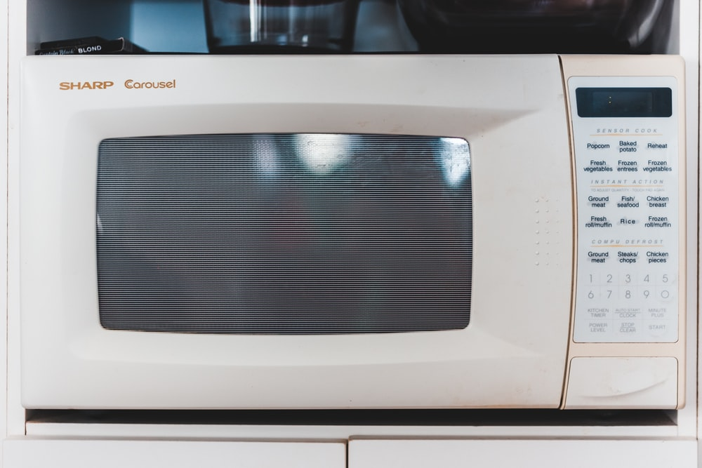 white microwave oven turned off