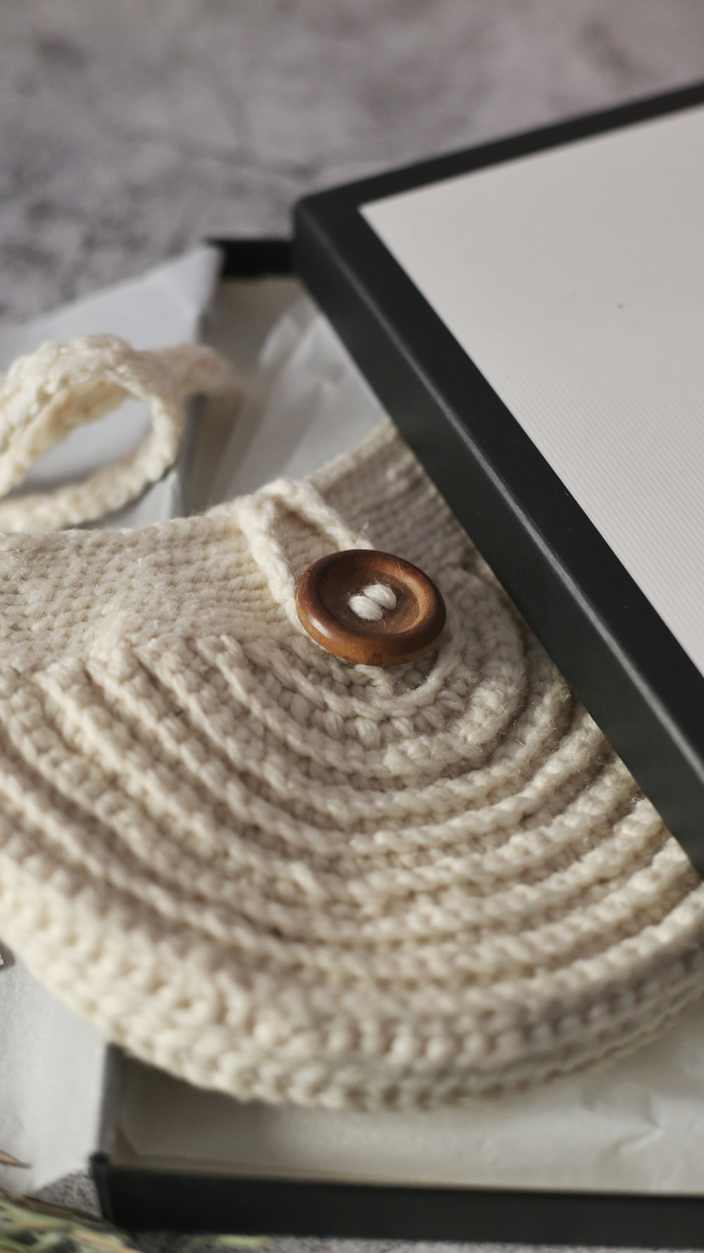 brown round ornament on white knit textile