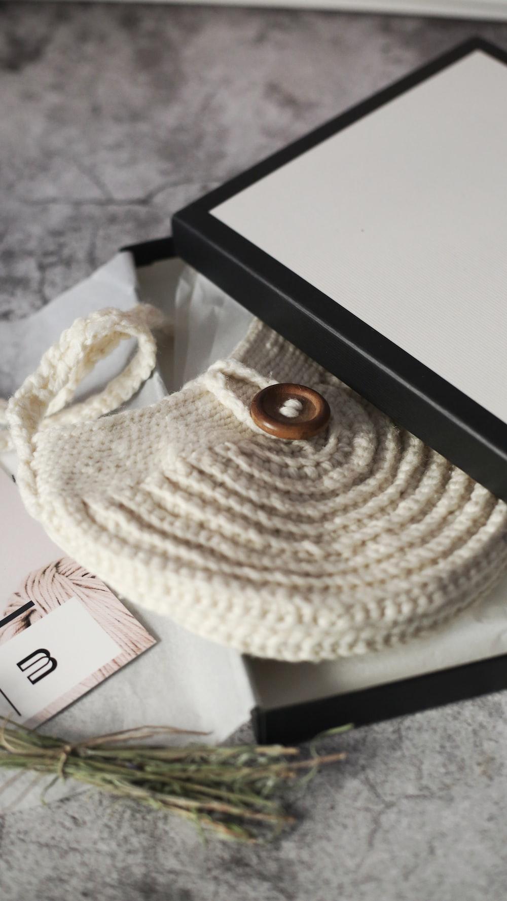 white knit cap on black table