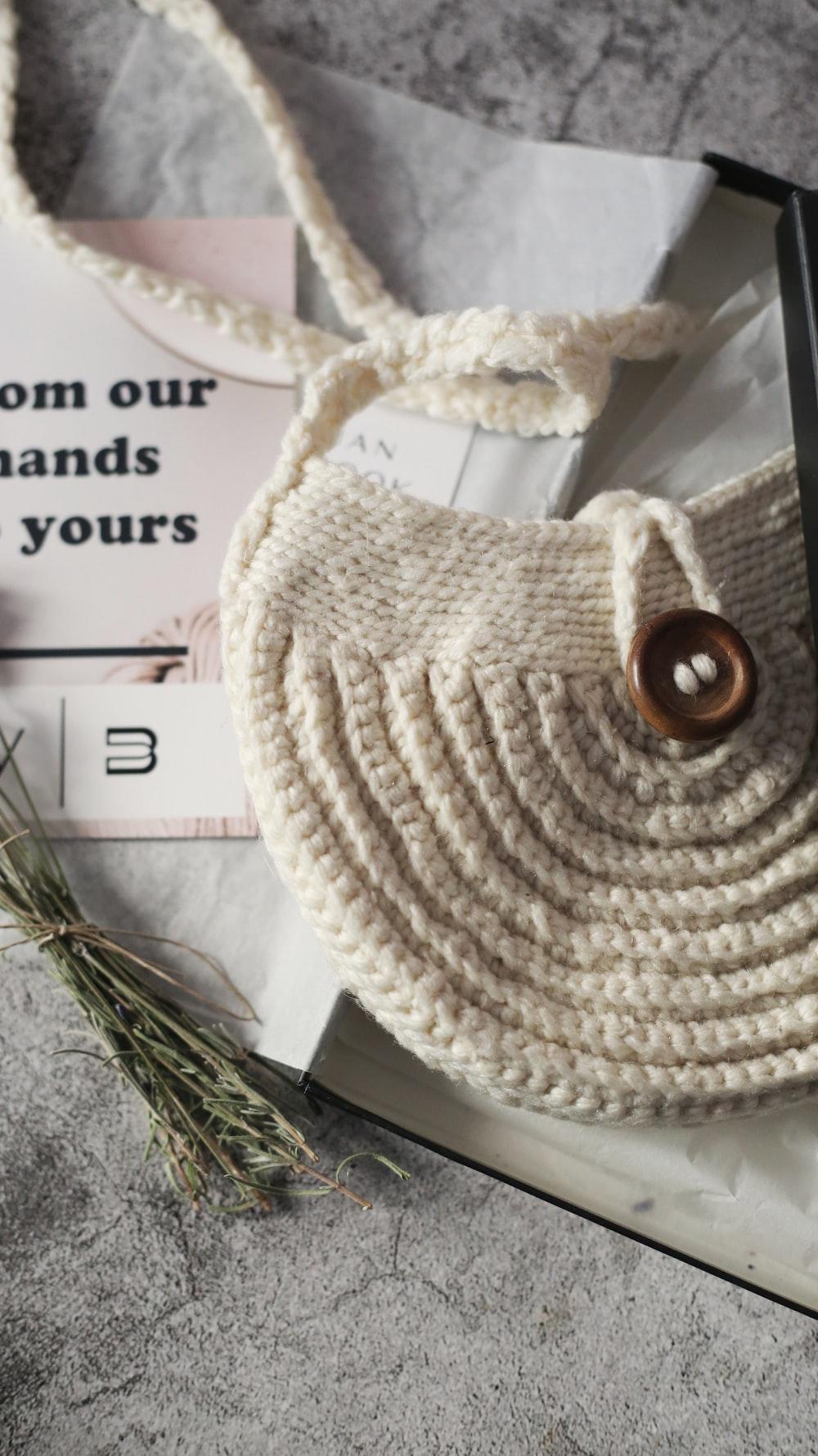 white knit round textile on white printer paper