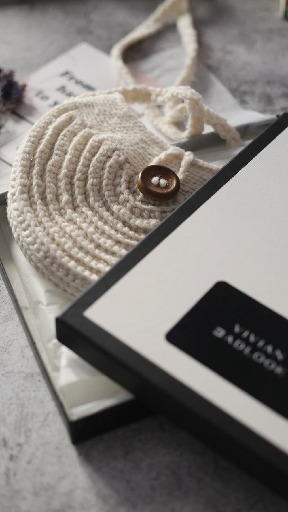 white and black box on white textile