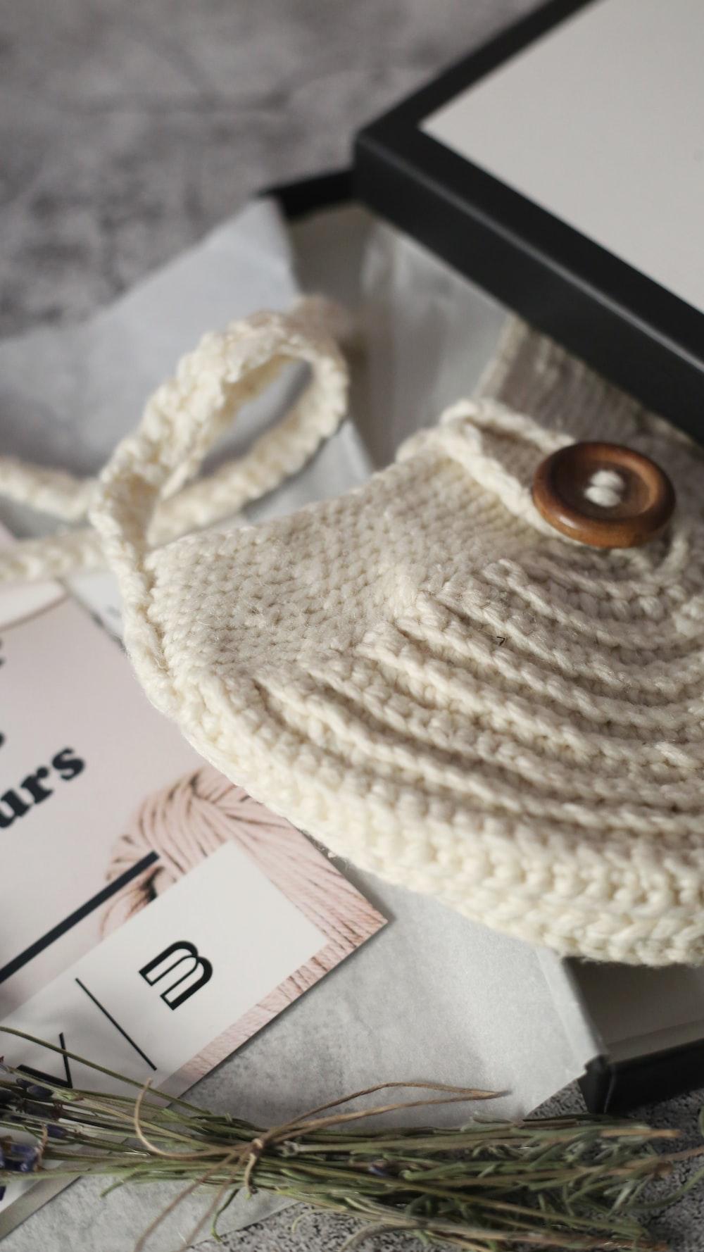white knit cap on white paper