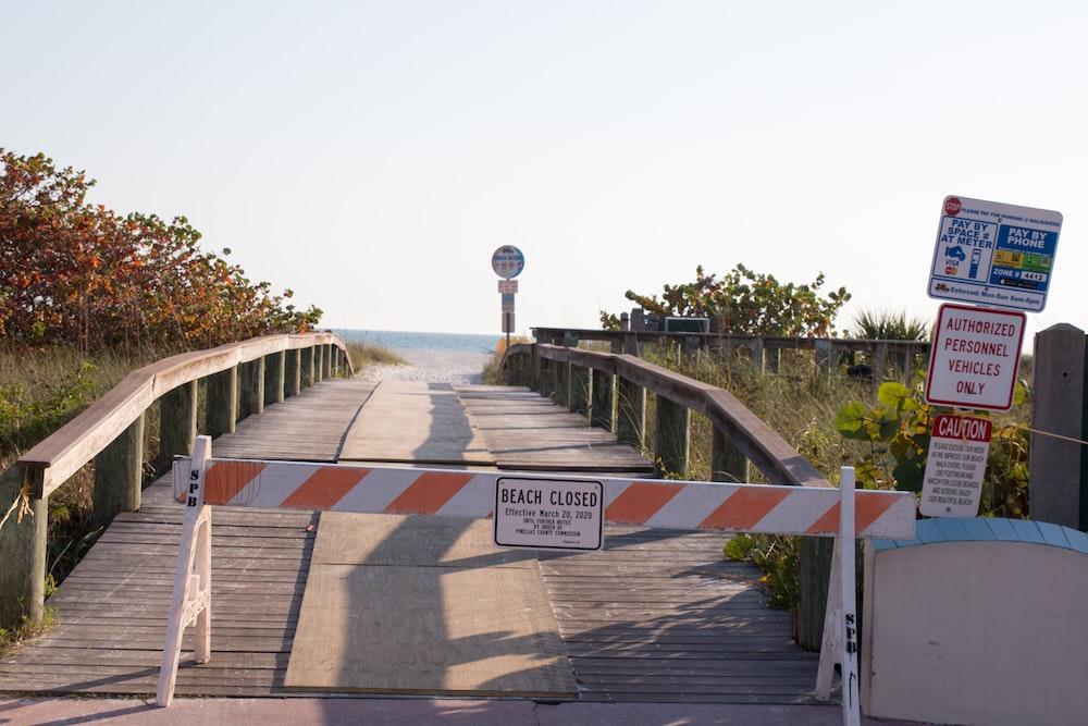 brown wooden bridge over the sea