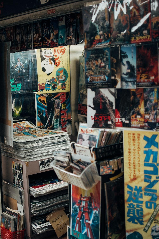 assorted magazines on white wooden shelf