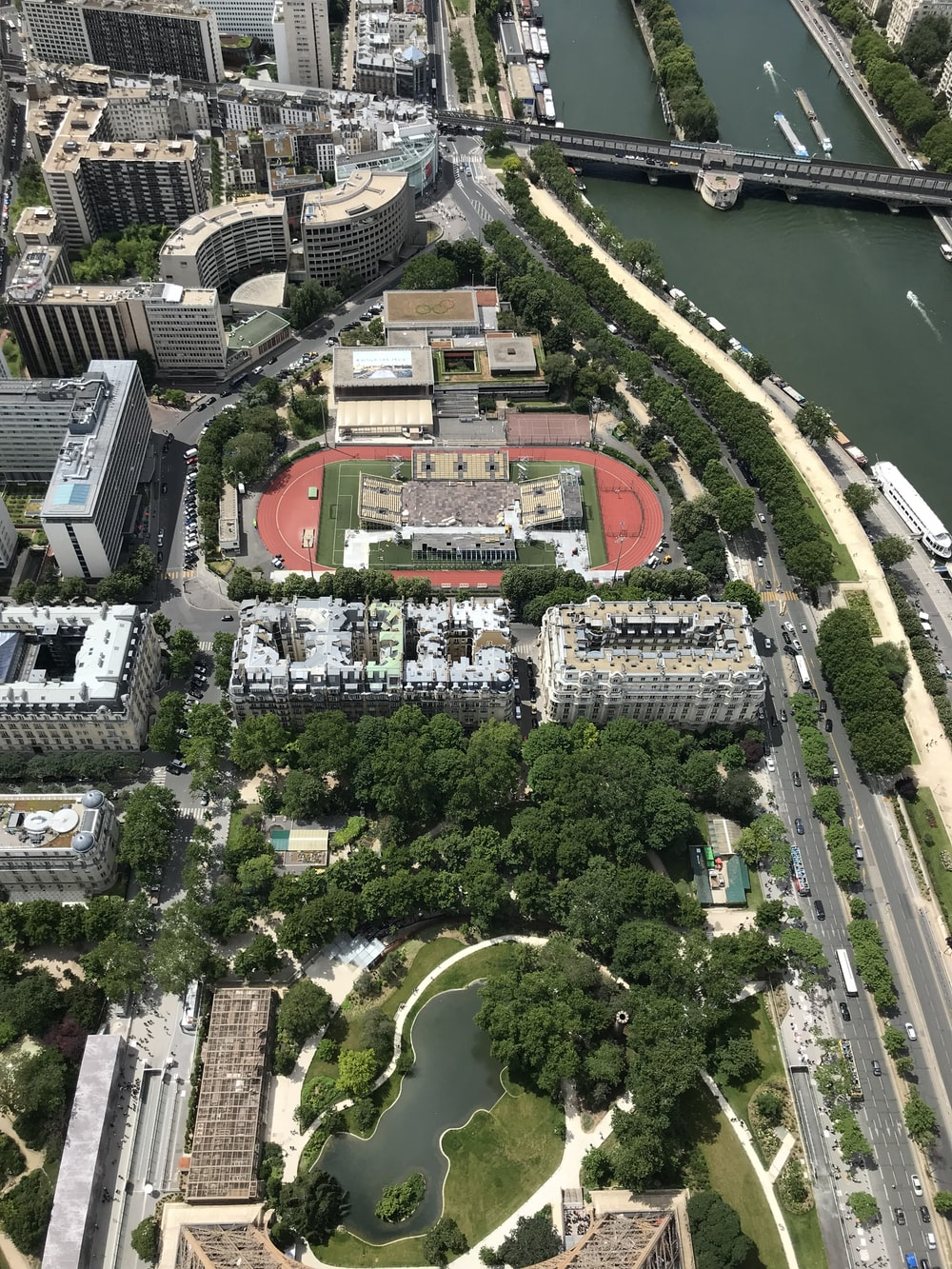 aerial view of city buildings and green trees during daytime