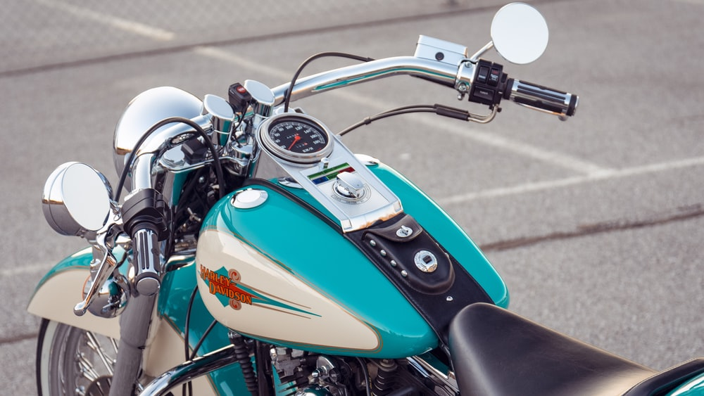 blue and silver motorcycle on road during daytime