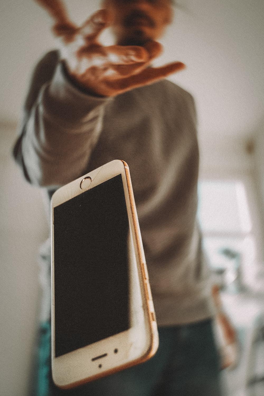person holding white ipad mini