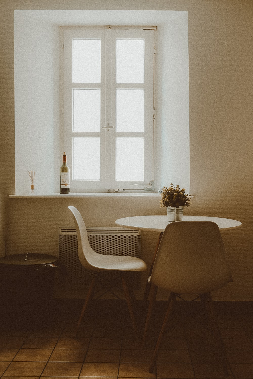 white and brown wooden chair near white wooden table