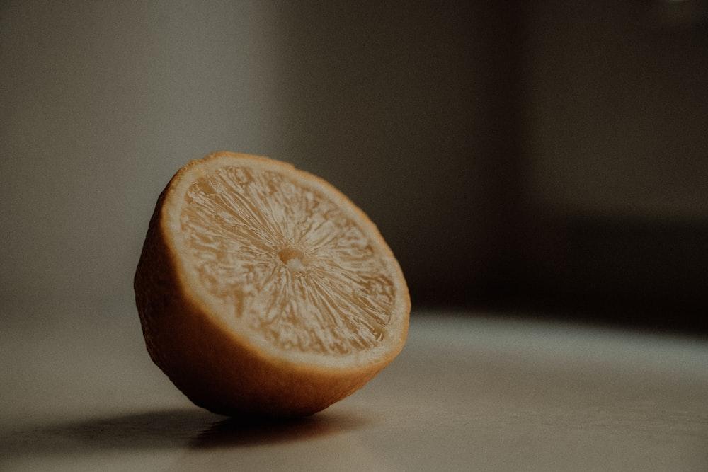 sliced lemon on white table
