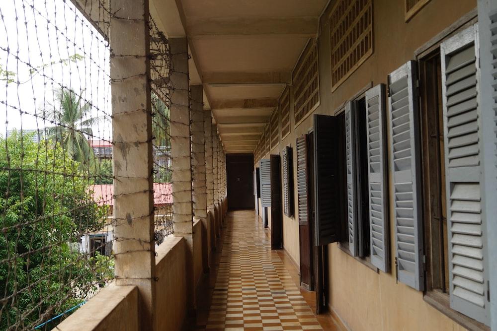 brown wooden hallway with glass windows