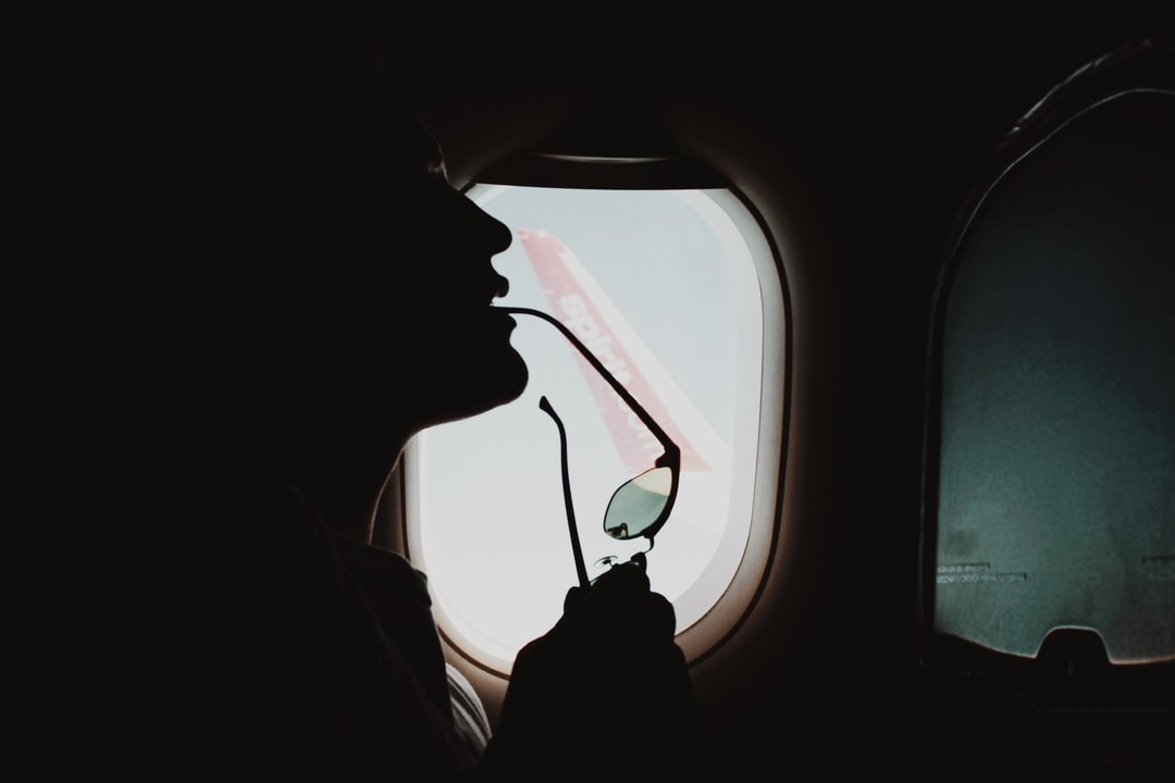 Person In Car Looking At the Window - unsplash