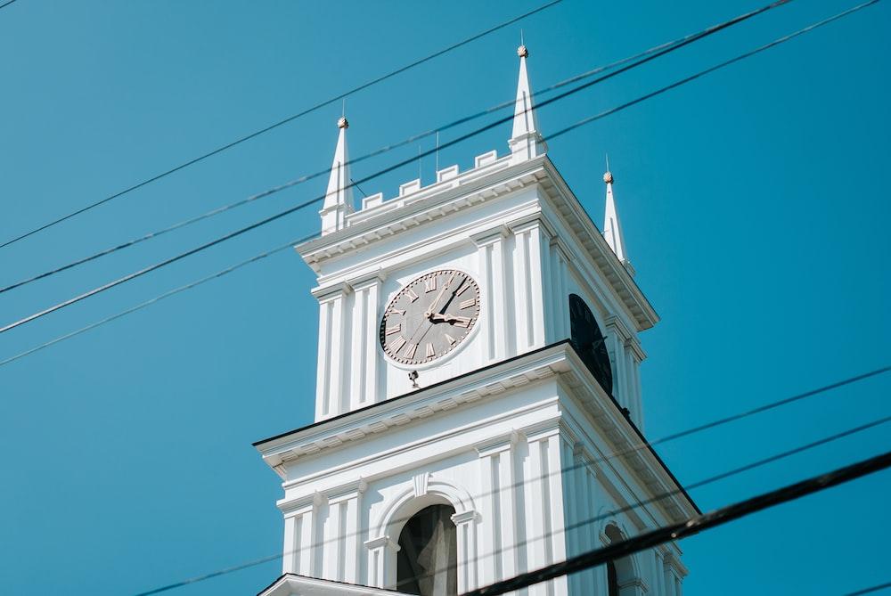 white clock tower under blue sky during daytime