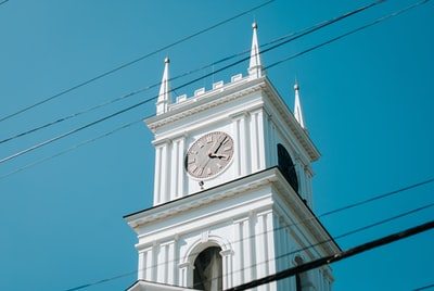 white clock tower under blue sky during daytime massachusetts zoom background