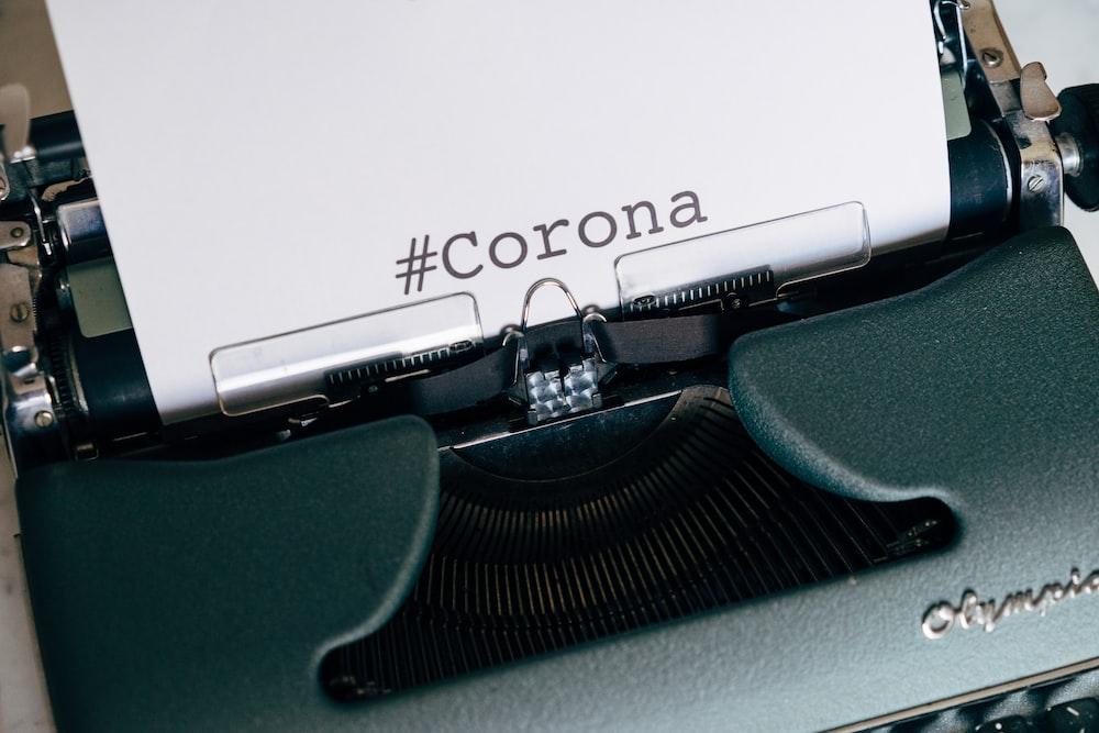green typewriter on white surface