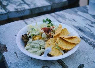 green vegetable salad on white ceramic plate