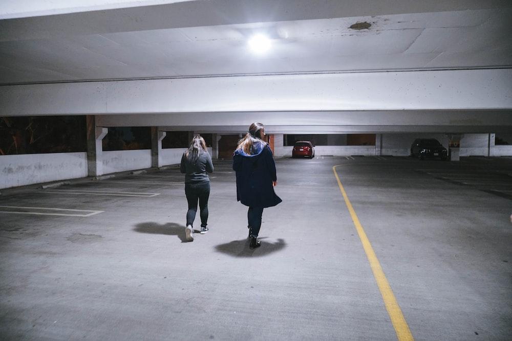 3 women standing on gray concrete floor