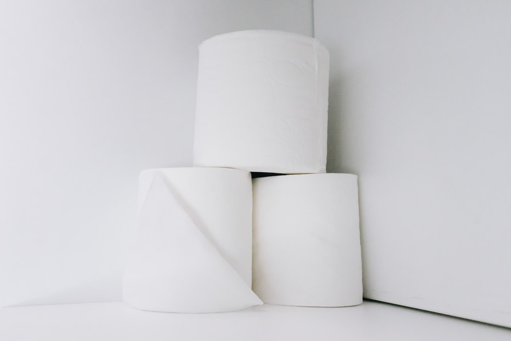 white toilet paper roll on white table